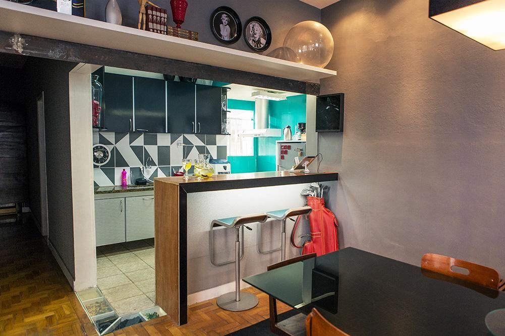 Cozinha americana integrada a sala de jantar de Casa Aberta ...