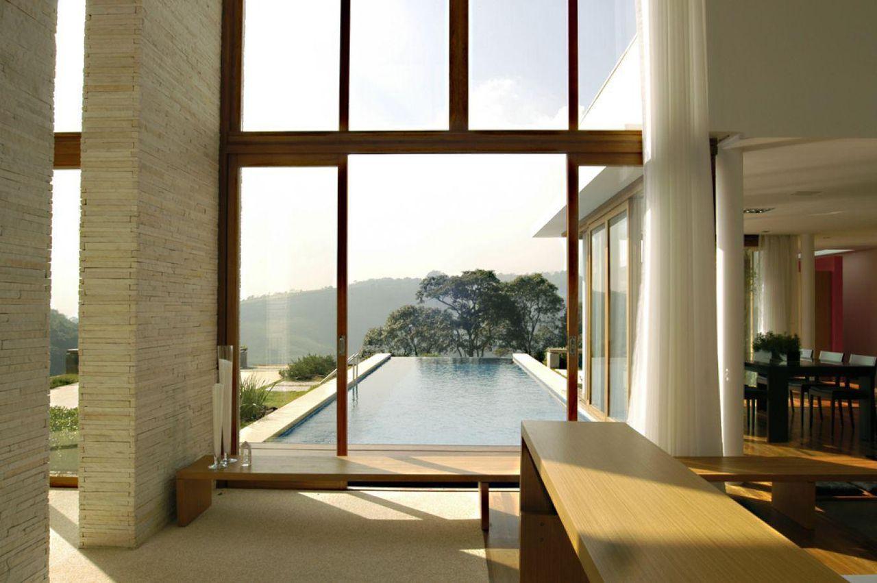 Sala com vista para a piscina de a1 arquitetura 75627 no for Sala de estar vista desde arriba
